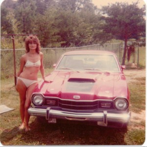My Mom posing with her car, the Bear Cat!  She was a hottie! lol